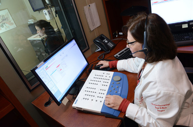 Audiologist conducting test