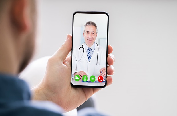Person using phone to talk to provider face to face (telemedicine)