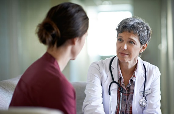 Physician meeting with a patient