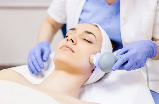 Woman receiving skin resurfacing treatment on her face