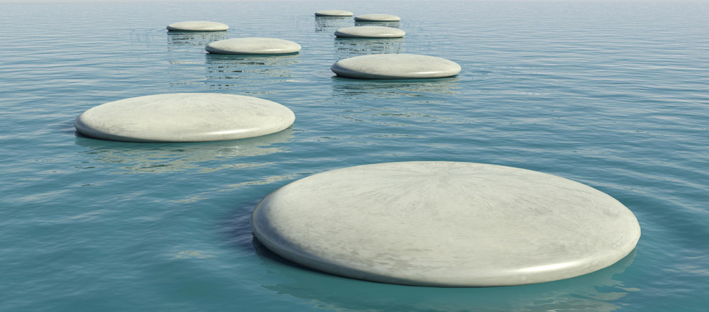 Image of flat rocks floating on water