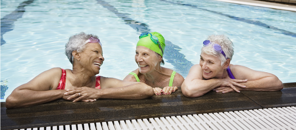 Three women in a swimming pool