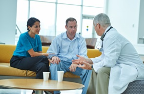 Doctor with Patient Couple